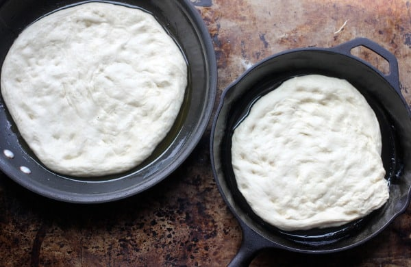 Dough in skillets waiting to be cooked for pan pizza