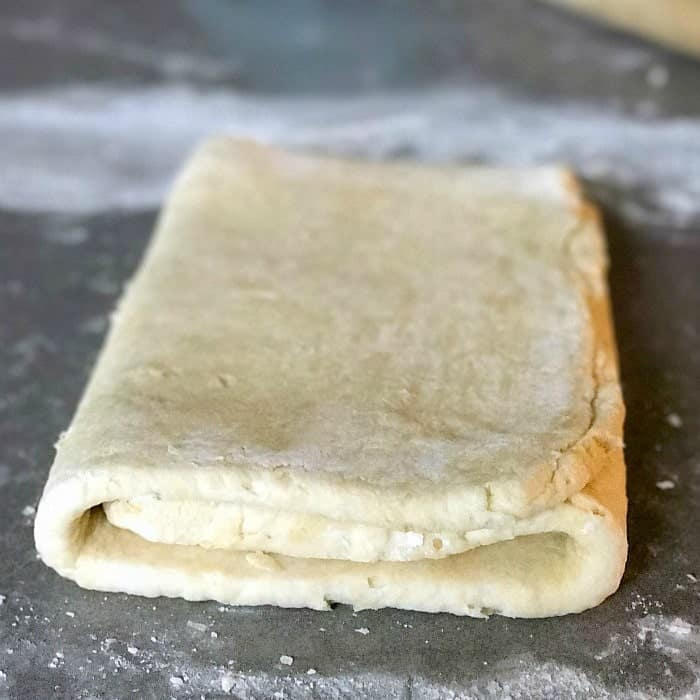 Quick puff pastry bakes up with all of the buttery flakiness of traditional puff pastry, but is ready to use in in under an hour! If you've ever wanted to get your feet wet with making a laminated dough, quick puff pastry is the perfect one to try first! Use this quick puff pastry dough to make a wide variety of sweet and savory creations!