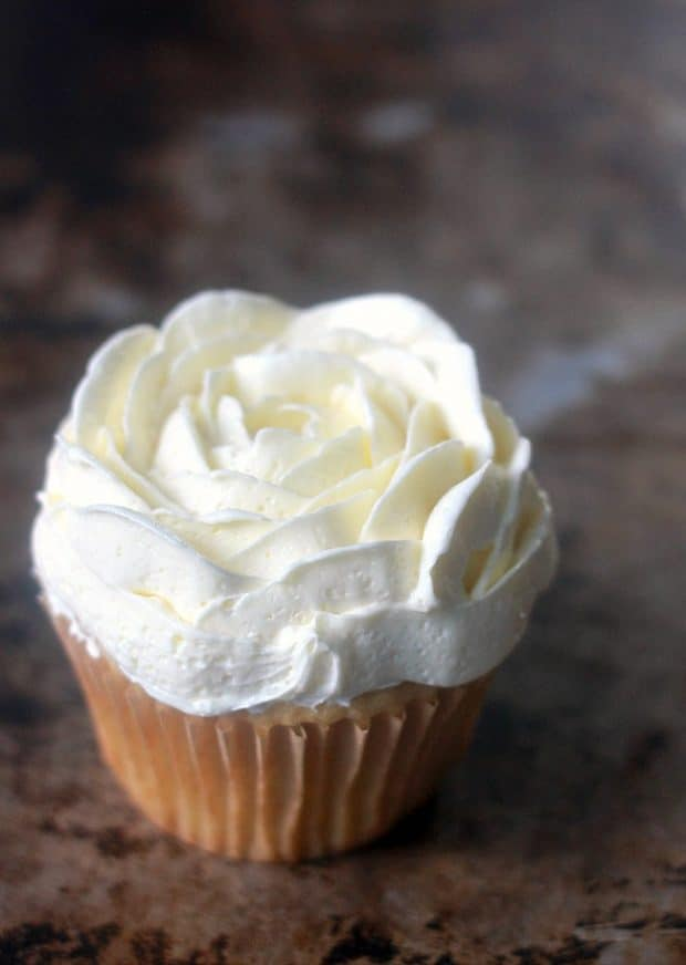 A decorated cupcake with soft buttercream
