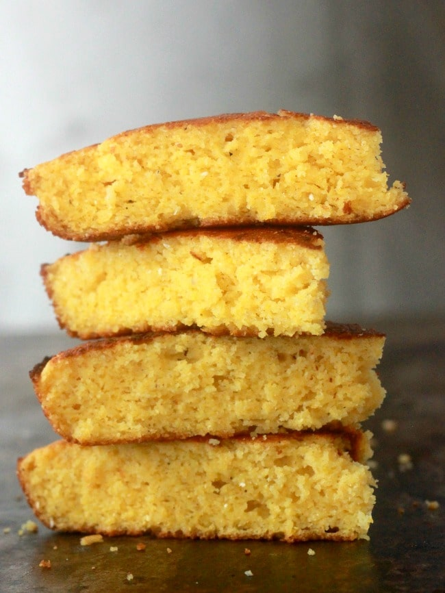This easy and moist cornbread recipe is a true southern treat made with tangy buttermilk and cooked in a cast iron skillet to achieve that iconic crispy bottom. This one bowl recipe is incredibly versatile and is a great base recipe to create endless variations!