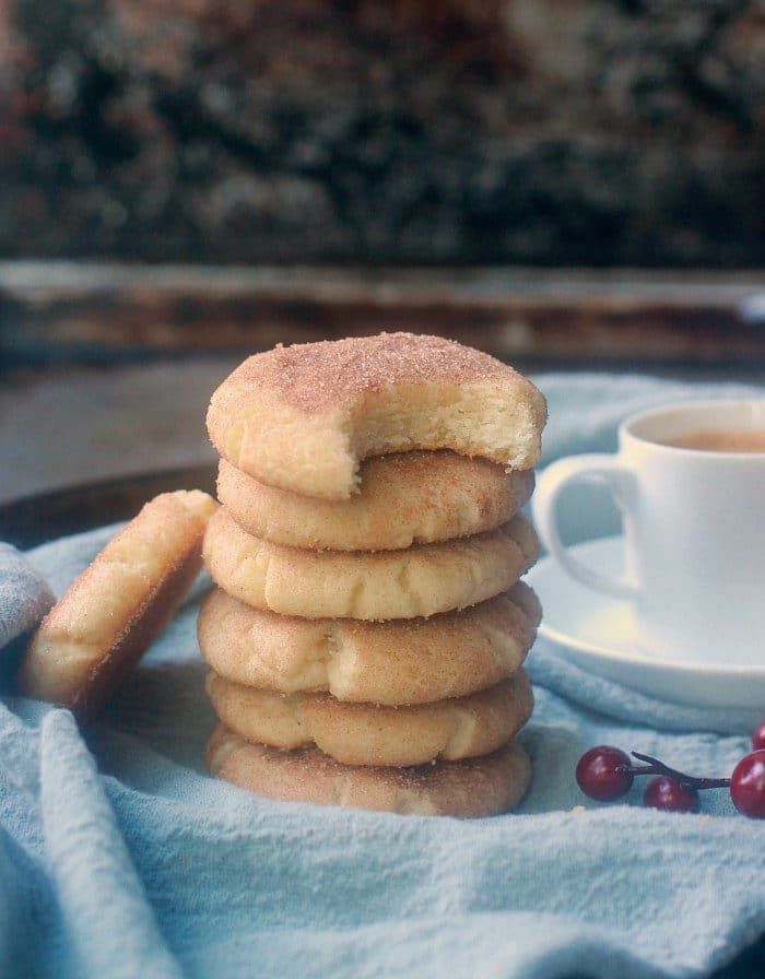 Soft snickerdoodles stacked up with coffee