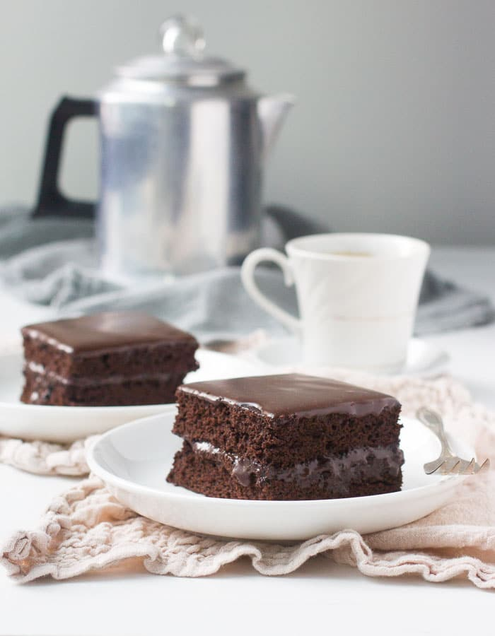 Slices of layered chocolate sheet cake