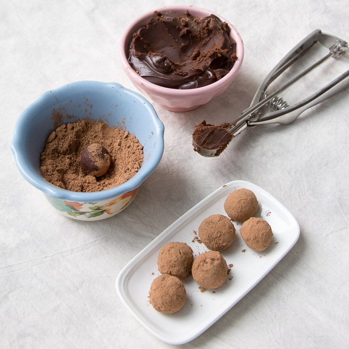 Chocolate truffles being made with chocolate ganache