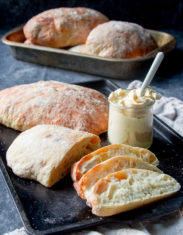 Loaves of ciabatta bread and slices of ciabatta bread