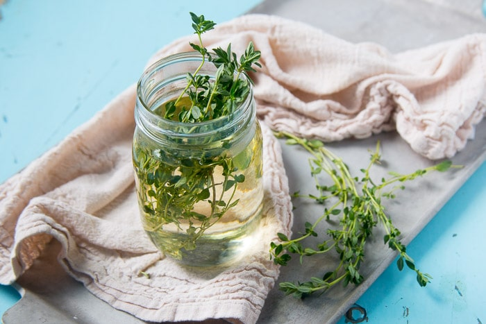Infusing simple syrup with fresh thyme.